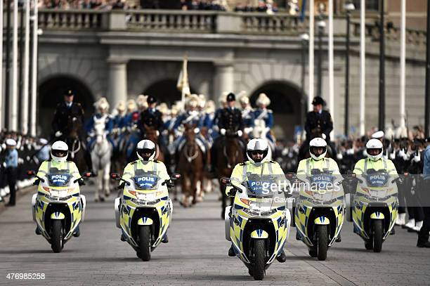 Police force is seen prior the wedding cortege following the wedding ceremony of Prince Carl Philip of Sweden and Princess Sofia of Sweden on June 13...