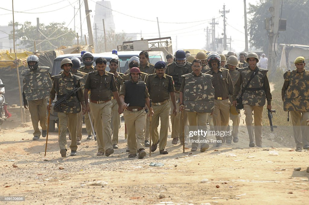 A police force patrolling the area after violence by mob angry after houses demolished in antiencroachment drive by Greater Noida Authority at...