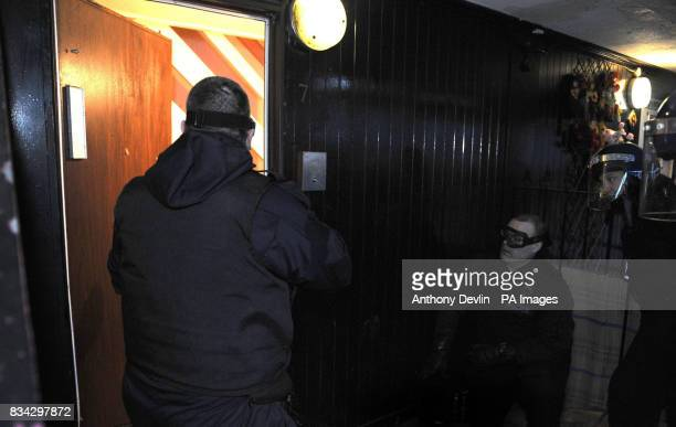 Police force their way into a property at Six Aces in Finsbury Park at dawn as part of Operation Mista