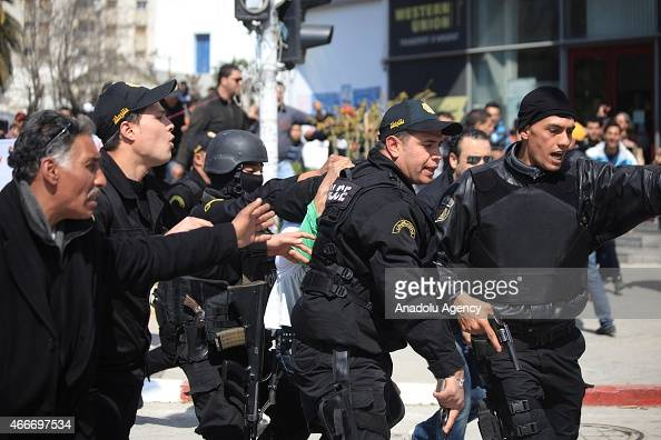 Police forces arrest a suspicious man when gunmen take an unknown number of tourists hostage at the National Bardo Museum near the country's...