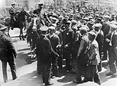 Police forces breaking up a gathering along the waterfront in San Francisco on the eve of the General Strike which involved over 200000 workers