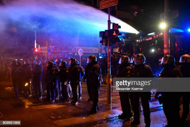 Police Forces clash with leftwing protesters after erecting burning barricades in front of the Rote Flora leftwing centre during a march on July 7...