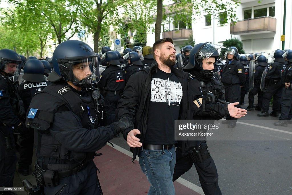 Police forces escort Eintracht Frankfurt fans through the city centre during the the Bundesliga Match of SV Darmstadt 98 and Eintracht Frankfurt at 'Merck-Stadion am Boellernfalltor' on April 30, 2016 in Darmstadt, Germany. The city of Darmstadt ordered a ban on fans of Eintracht Frankfurt entering the city for 36 hours, which has now been overturned.