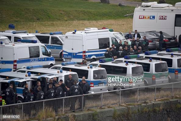 Police forces gather ahead of a rally of supporters of Turkish President Recep Tayyip Erdogan on July 31 2016 in Cologne as tensions over Turkey's...