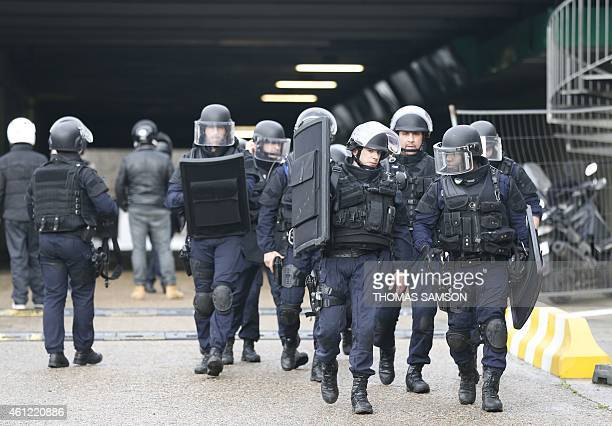 Police forces gather together at Porte de Vincennes eastern Paris after at least one person was injured when a gunman opened fire at a kosher grocery...