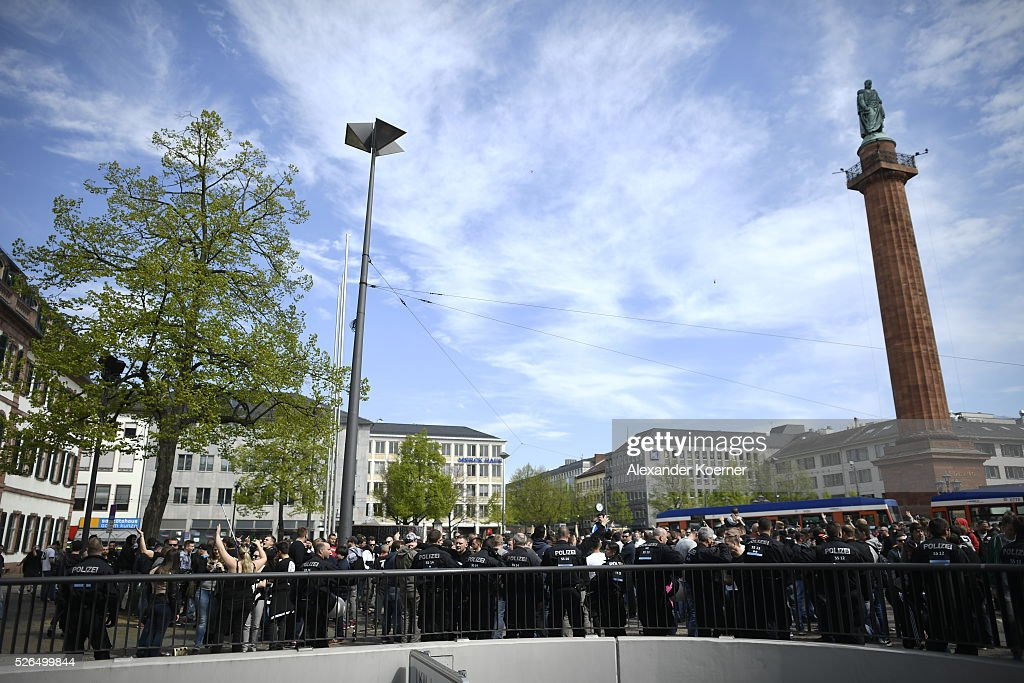 Police forces guard fans of Eintracht Frankfurt through the city centre prior the the Bundesliga Match of SV Darmstadt 98 and Eintracht Frankfurt at 'Merck-Stadion am Boellernfalltor' on April 30, 2016 in Darmstadt, Germany. Fans of Eintracht Frankfurt burnt scarves and banners during the first leg game in December 2015 of SV Darmstadt 98. The city of Darmstadt has rejected a ban of staying for fans of Eintracht Frankfurt for 36 hours inside the city centre and the stadium during the morning hours.