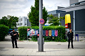 Police forces guard the crime scene outside the OEZ shopping center and the McDonalds the day after a shooting spree left nine victims dead on July...