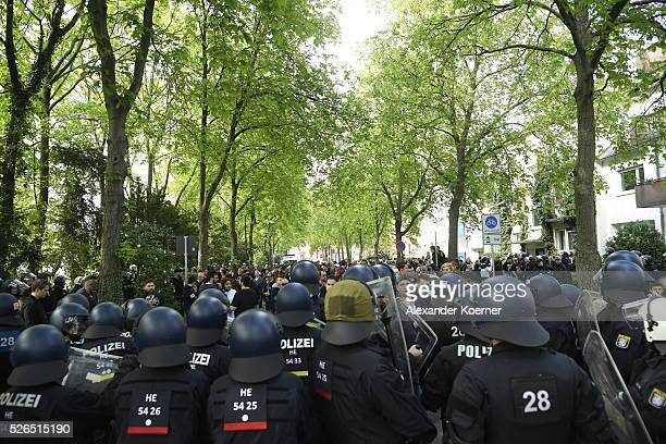 Police forces have surrounded some 150 Eintracht Frankfurt fans while escorting them through the city centre during the the Bundesliga Match of SV...