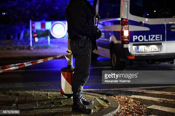 Police forces secure a scene after finding a suspicious piece of luggage prior the match Germany against the Netherlands at the HDIArena on November...