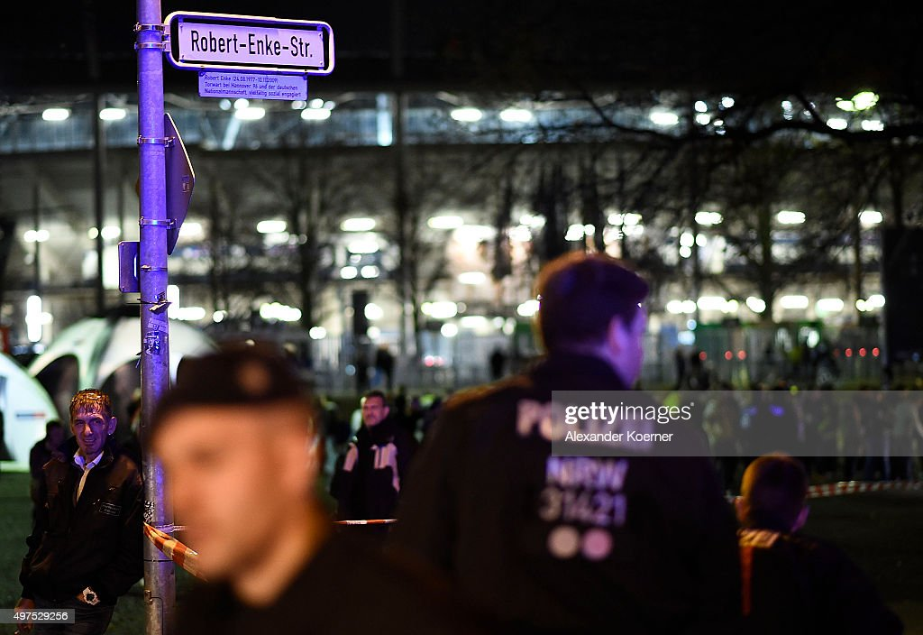 Police forces secure a scene at RobertEnkeStrasse after finding a suspicious piece of luggage prior the match Germany against the Netherlands at the...