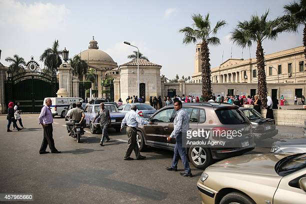 Police forces stand guard in front of Cairo University as students enter the campus on October 27 2014 in Cairo Egypt