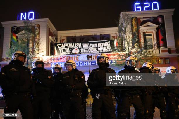 Police Forces stand guard outside 'Rote Flora' after clashing with left wing protesters after a march on May Day on May 01on May 1 2017 in Hamburg...