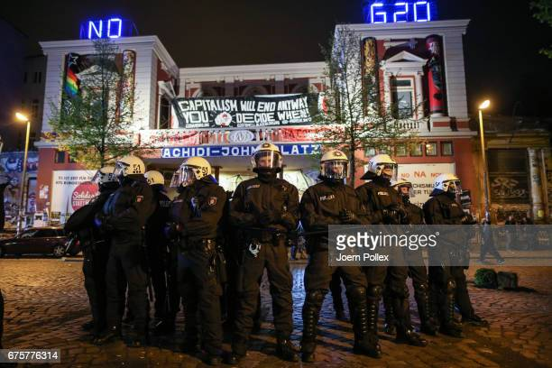 Police Forces stand guard outside 'Rote Flora' after clashing with left wing protesters after a march on May Day on May 1 2017 in Hamburg Germany...