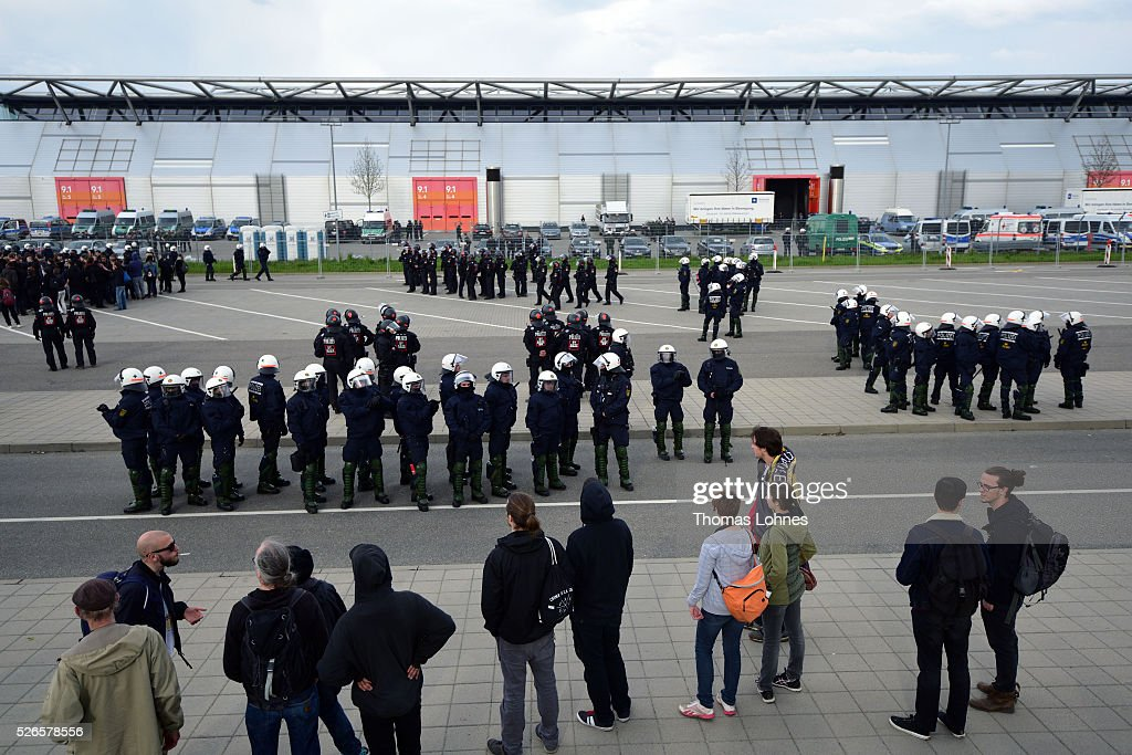 Police forces stand in front of a fair hall near the Alternative fuer Deutschland party's federal congress at the Stuttgart Congress Centre ICS on April 30, 2016 in Stuttgart, Germany. Police force arrestet hundrets of anto-AfD-protestors. The AfD, a relative newcomer to the German political landscape, has emerged from Euro-sceptic conservatism towards a more right-wing leaning appeal based in large part on opposition to Germany's generous refugees and migrants policy. Since winning seats in March elections in three German state parliaments the party has sharpened its tone, calling for a ban on minarets and claiming that Islam does not belong in Germany.