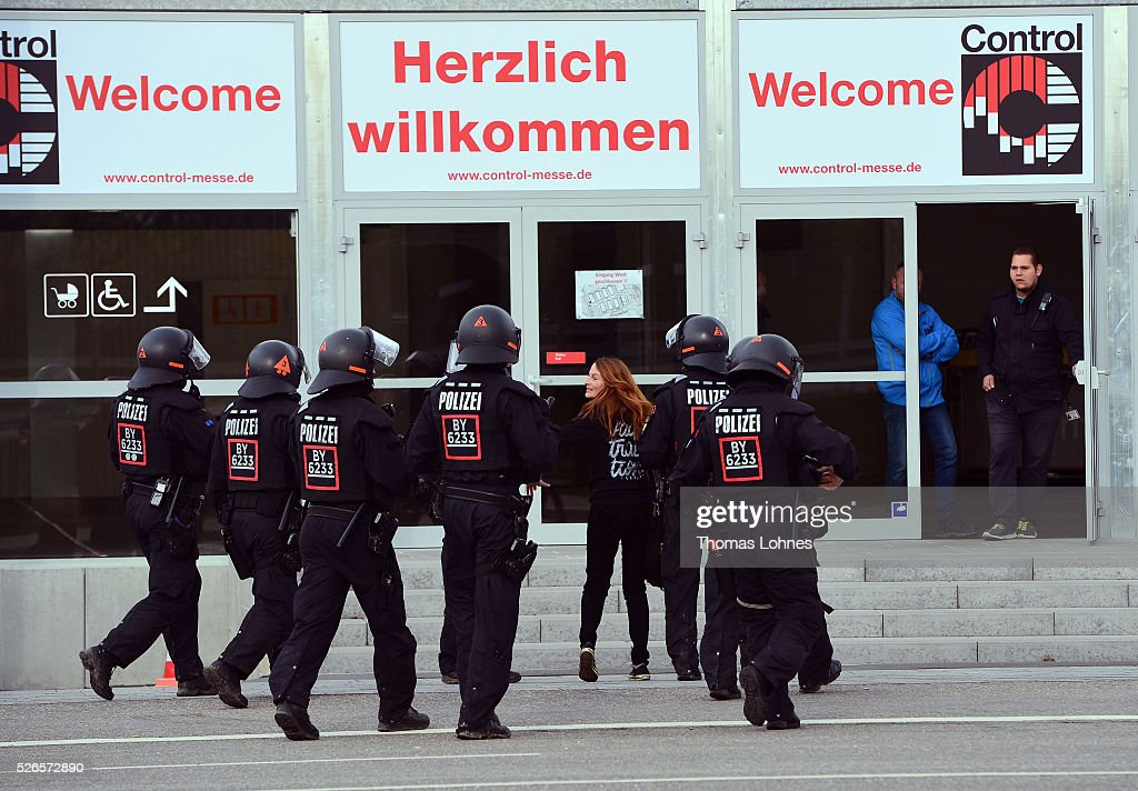 Police forces take an anti-AfD-protester into custody near the AfD (Alternative fuer Deutschland) party's federal congress at the Stuttgart Congress Centre ICS on April 30, 2016 in Stuttgart, Germany. The AfD, a relative newcomer to the German political landscape, has emerged from Euro-sceptic conservatism towards a more right-wing leaning appeal based in large part on opposition to Germany's generous refugees and migrants policy. Since winning seats in March elections in three German state parliaments the party has sharpened its tone, calling for a ban on minarets and claiming that Islam does not belong in Germany.