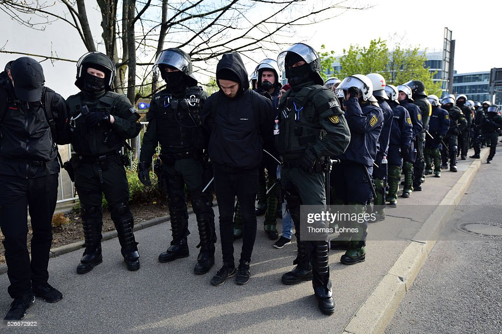 Police forces take anti-AfD-protesters into custody near the AfD (Alternative fuer Deutschland) party's federal congress at the Stuttgart Congress Centre ICS on April 30, 2016 in Stuttgart, Germany. The AfD, a relative newcomer to the German political landscape, has emerged from Euro-sceptic conservatism towards a more right-wing leaning appeal based in large part on opposition to Germany's generous refugees and migrants policy. Since winning seats in March elections in three German state parliaments the party has sharpened its tone, calling for a ban on minarets and claiming that Islam does not belong in Germany.