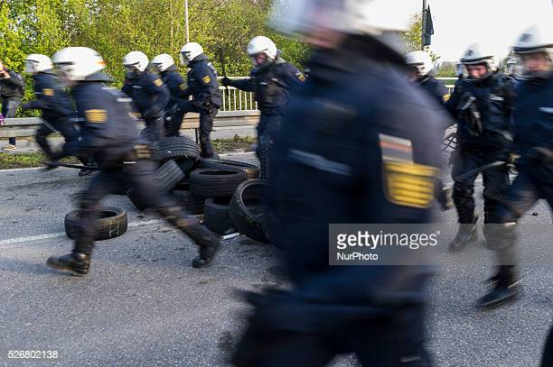 Police forces take antiAfDprotesters into custody near the AfD party's federal congress at the Stuttgart Congress Centre ICS on April 30 2016 in...