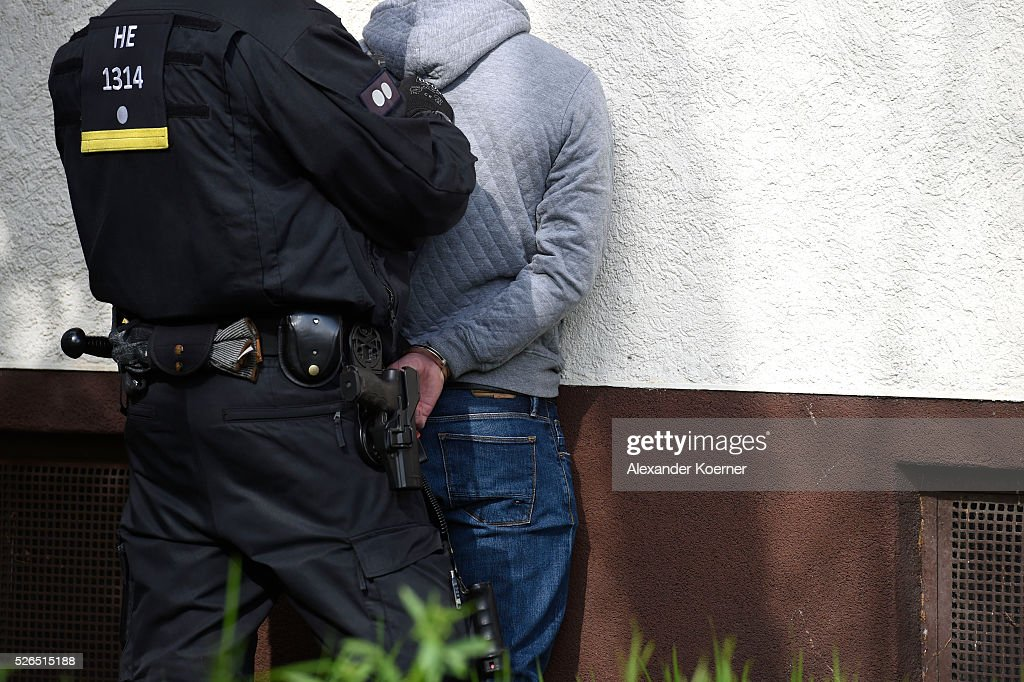 Police forces take the ID of an Eintracht Frankfurt fan while escorting fans through the city centre during the the Bundesliga Match of SV Darmstadt 98 and Eintracht Frankfurt at 'Merck-Stadion am Boellernfalltor' on April 30, 2016 in Darmstadt, Germany. The city of Darmstadt ordered a ban on fans of Eintracht Frankfurt entering the city for 36 hours, which has now been overturned.