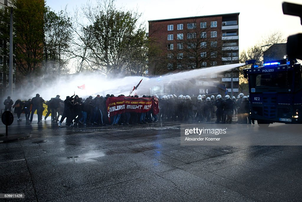 Police forces use a water cannon against leftist protesters on May Day on 01 May, 2016 in Hamburg, Germany. Tens of thousands of people across Germany participated in marches and gatherings by labor unions and in some cities left-wing and anarchist activists took to the streets under heavy oversight by police.
