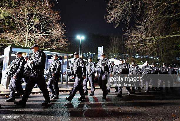 Police forces walk in front of the evacuated HDI Arena prior to the International Friendly match between Germany and Netherlands at HDI Arena on...