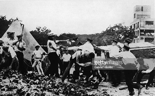 Police forcibly remove World War I Bonus March demonstrators from their shanty campsites in Washington DC July 1932 The Bonus Marchers were comprised...