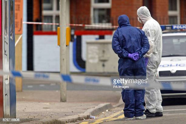 Police Forenics team search for clues around the scene were a man was shot dead as he drove a lorry in east Belfast The victim was hit several times...