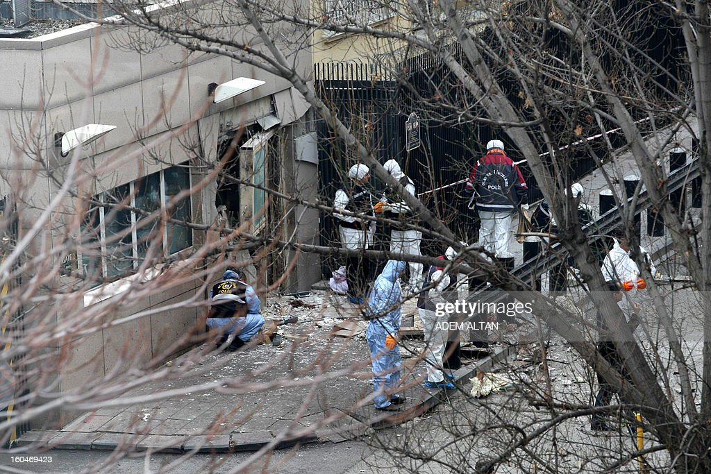 Police forensic experts work on February 1, 2013 at the site of a blast outside the US Embassy in Ankara. Two security guards were killed in the blast outside the US embassy, local television reported, amid speculation it was a suicide attack. The force of the explosion damaged nearby buildings in the Cankaya neighborhood where many other state institutions and embassies are also located.