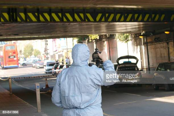 A police forensic officer at the scene on Stroud Green Road Finsbury Park north London where two men were injured in a clash between two groups early...
