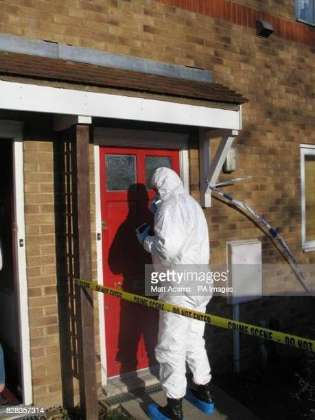 A police forensic officer searches a house in Lambersart Close near Southborough in Kent Sunday February 26 as the search for the Securitas depot...