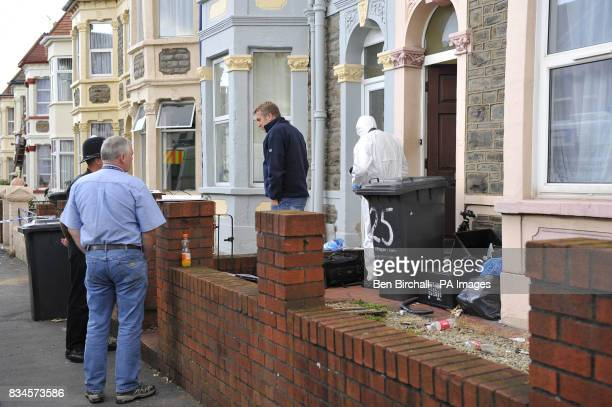 A police forensic officer searches a property in Belle Vue Road Easton Bristol while a policeman stands guard outside after a 19yearold man was...