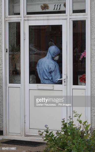 A police forensic officer searches inside number 111 Park Lane in Carshalton where a fiveyearold boy and a fouryearold girl have died after being...