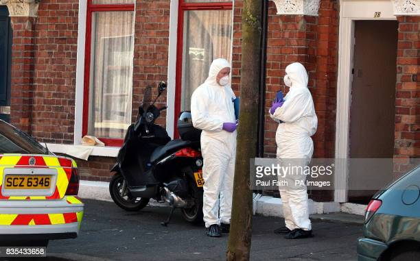 Police forensic officers at the scene outside a house in Fitzroy Avenue south Belfast where a 44yearold man died following a stabbing shortly before...