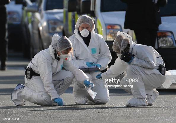 Police forensic officers conduct a fingertip search outside a house in Hattersley Tameside where two female police officers were shot today on...