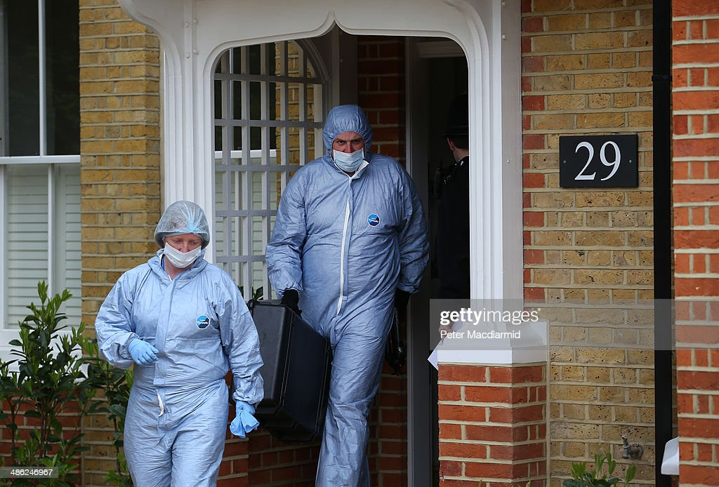 Police forensic officers leave a house in New Malden where the bodies of three children were found on April 23, 2014 in south London, England. Police say that a 43 year old woman has been arrested after the bodies of three children were found at a property last night.