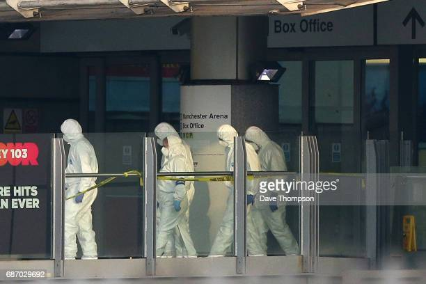 Police forensic officers leave the Manchester Arena as they investigate the scene of an explosion on May 23 2017 in Manchester England An explosion...