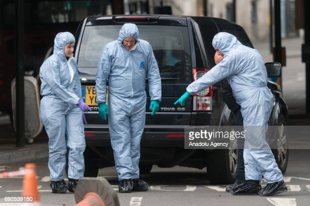 Police forensic officers search for evidence outside The Barrowboy and Banker pub tavern south of London Bridge in London England on June 05 2017...