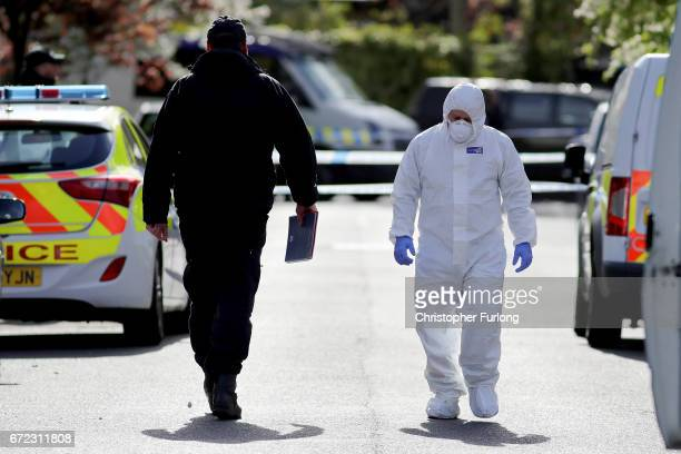 Police forensic officers work near the scene in Cranbourne Rd ChorltoncumHardy where exRoyal Navy officer Michael Samwell was fatally injured as he...
