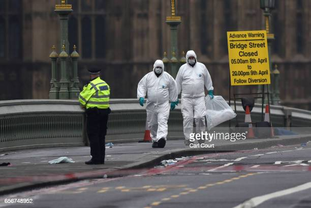 Police forensic officers work on Westminster Bridge following yesterday's attack on March 23 2017 in London England Four people have been killed and...