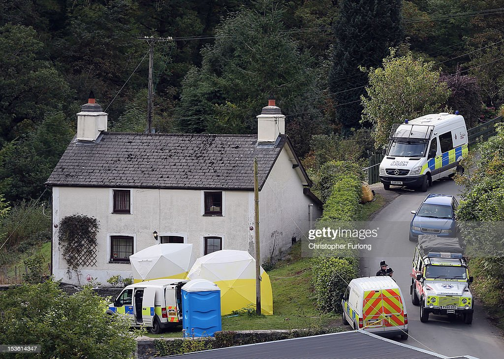 Police forensic scientists work at the house of Mark Bridger in the village of Ceinws as the search for missing April Jones continues on October 7, 2012 in Machynlleth, Wales. Earlier hundreds of local people walked from April's home in Bryn-y-Gog to the local church in the centre of Machynlleth where the Bishop of Bangor Andrew John held a service. Police have charged local man Mark Bridger with murder, child abduction and attempting to pervert the course of justice. Five-year-old April Jones was abducted from outside her house on Monday night in Machynlleth.