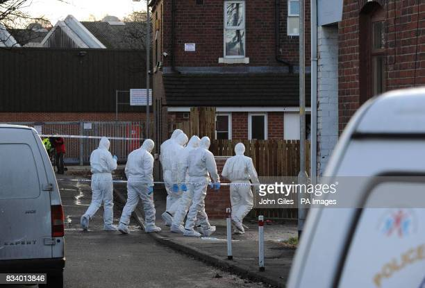 Police forensic teams at the house in Wakefield where ArchieLee Hirst was killed by a dog