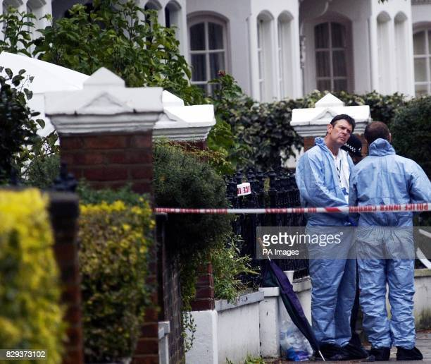 Police forensic teams conduct an extensive search of the property on a treelined street among rows of exclusive houses and flats where a middleaged...