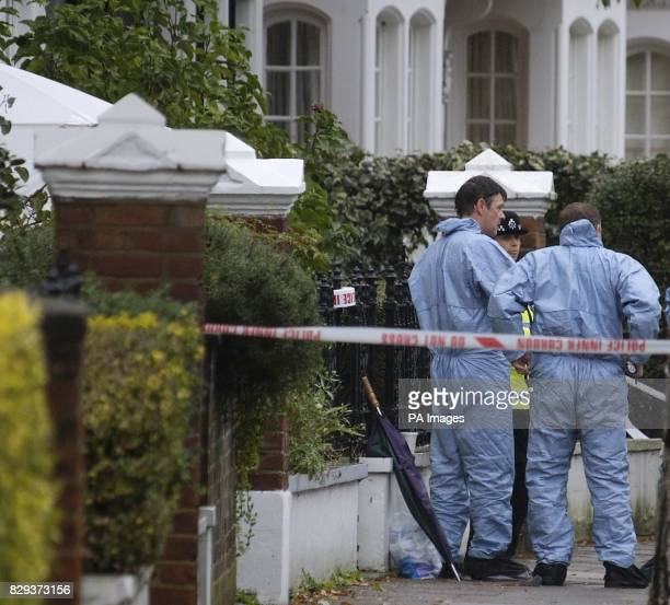 Police forensic teams conduct an extensive search of the property on a treelined street among rows of exclusive houses and flats in Airedale Avenue...