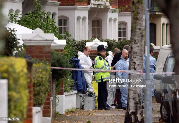 Police forensic teams outside the house in Chiswick London where a middleaged man is believed to have been stabbed to death as he attempted to fend...