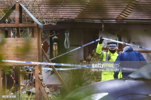 Police forensics arrive at a house in Smuggler's Lane Bosham West Sussex where a 55 year old woman was found murdered