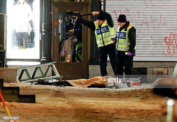 Police forensics experts examine the remains of a suspected suicide bomber in Stockholm on December 11 2010 The man was found dead after an explosion...