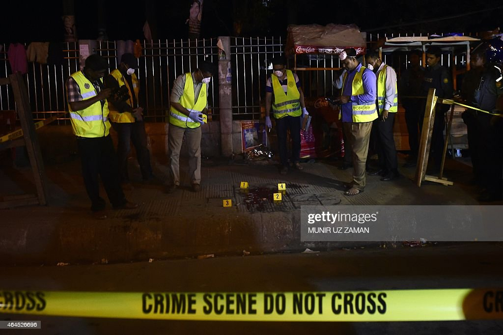 Police forensics investigate the scene where US blogger of Bangladeshi origin was hacked to death by unidentified assailants in Dhaka on February 27...