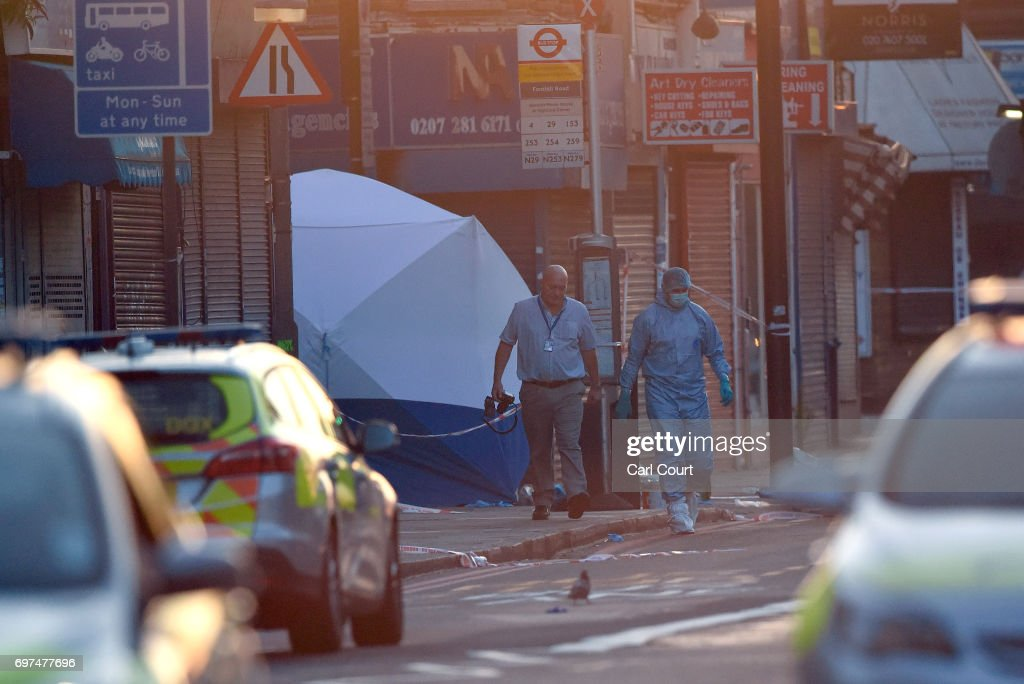 A police forensics officer walks from the scene where a van is believed to be involved in an incident near Finsbury Park Mosque in which the van ploughed into pedestrians, on June 19, 2017 in London, England. According to reports, worshipers were struck as they were leaving a mosque in North London after Ramadan prayers.