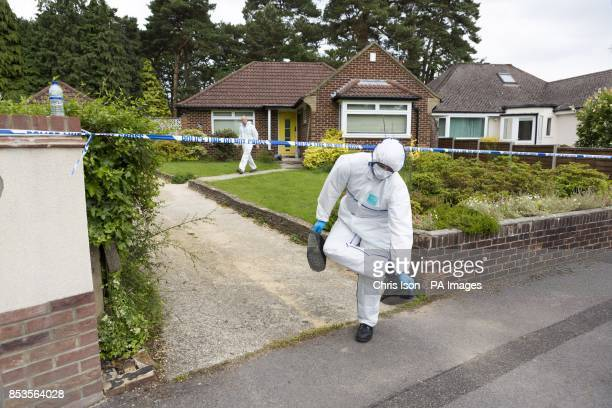 Police forensics officers at the home of missing nurse Rui Li in Burnham Drive in Bournemouth after detectives searching for Ms Li who has not been...