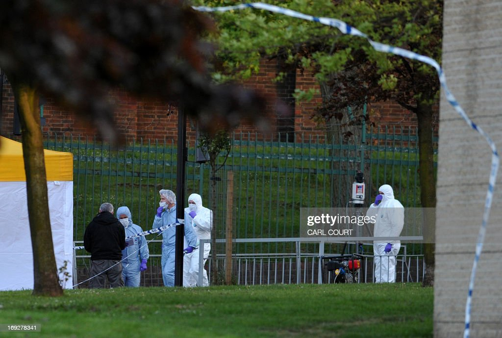 Police forensics officers carry out investigations at the site where a soldier was murdered in Woolwich, east London, on May 22, 2013. A man believed to be a serving British soldier was brutally murdered near a London barracks in what Prime Minister David Cameron said appeared to be a terrorist attack. Cameron called the attack 'appalling' and said: 'There are strong indications that it is a terrorist incident.'