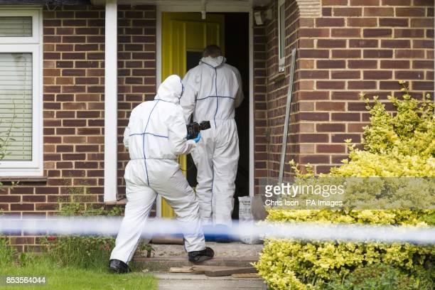 Police forensics officers enter the home of missing nurse Rui Li in Burnham Drive in Bournemouth after detectives searching for Ms Li who has not...